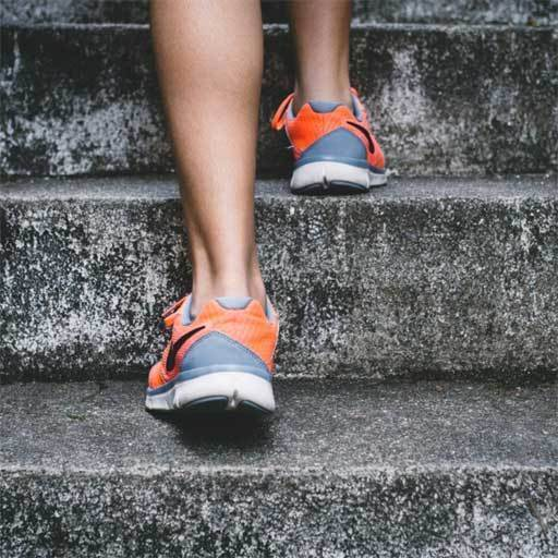 Person climbing stairs - changing your life starts with a single step
