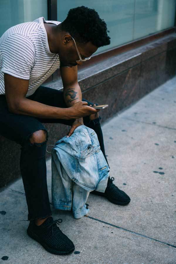 Man Reading While He Waits