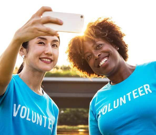 Financial Personality Type #4 - Pleasers - Volunteers taking a selfie