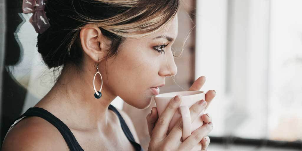Woman drinking coffee for productivity